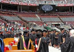 Graduates receive their diplomas during commencement on June 10 at Ohio Stadium.