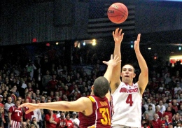 OSU junior guard Aaron Craft (4) shoots a game-winning 3-pointer during the March 24 NCAA Tournament game against Iowa State. With the 78-75 win, OSU advanced to the Sweet 16.