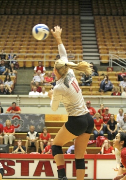 Shelby Lum / Photo editor Senior outside hitter Kaitlyn Leary (11) spikes the ball during a match against Dabrowa Sept. 4, at St. John Arena. OSU won, 3-2.