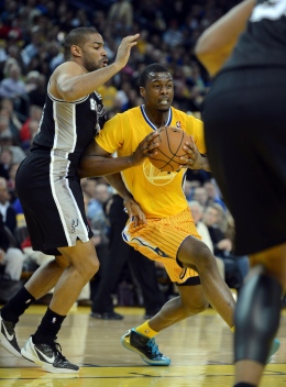 Courtesy of MCT The Golden State Warriors' Harrison Barnes drives to the basket against the San Antonio Spurs in the first quarter at the Oracle Arena in Oakland, California, on Friday, February 22, 2013.