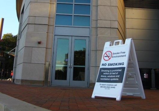 A sign prohibiting smoking in front of the William Oxley Thompson Memorial Library. Ohio State is implemented a plan to make campus tobacco-free Aug. 1. Credit: Lantern file photo