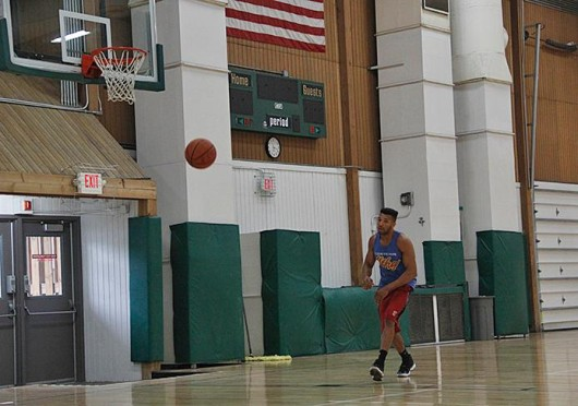 Kieffer Gray, fourth-year in electrical engineering, plays basketball at JO South Aug. 27 on the new wooden courts, intended to be used for a variety of activities. Credit: Chelsea Spears / Asst. multimedia editor