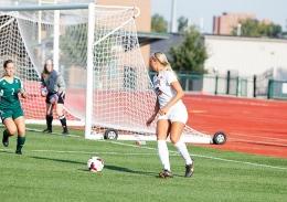Shelby Lum / Photo editor Senior midfilder Kristen Niederhaus looks for an open teammate during a game against Eastern Michigan on Aug. 25, at Jesse Owen's Memorial Stadium. OSU won, 2-1.