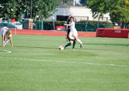 Shelby Lum / Photo editor Senior Danica Wu battles with a defender during a game against Eastern Michigan on Aug. 25, at Jesse Owens Memorial Stadium. OSU won, 2-1.