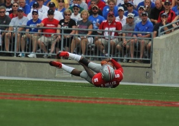Shelby Lum / Photo editor Junior quarterback, Braxton Miller, falls on the field. The Ohio State football team beat the University of Buffalo, 40-20, Aug. 31 at Ohio Stadium.