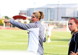 Shelby Lum / Photo editor Women's soccer coach Lori Walker directs her players during a game against Eastern Michigan on Aug. 25, at Jesse Owens Memorial Stadium. OSU won, 2-1.