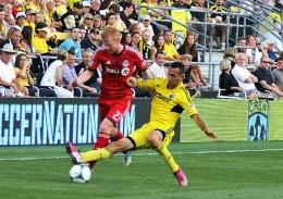 Shelby Lum / Photo editor Columbus Crew midfielder Justin Meram makes a sliding tackle during a game against Toronto FC Aug. 17, at Crew Stadium. The Crew won, 2-0.