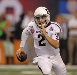 Courtesy of MCT Then-redshirt-freshman quarterback for Texas A&M Johnny Manziel runs the ball during a game against Oklahoma on Jan. 4, at Cowboys Stadium. A&M won, 41-31.