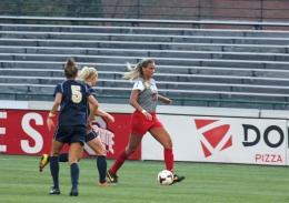Shelby Lum / Photo editor Senior midfielder Kristen Niederhaus avoids a defender during a game against Pittsburgh on Aug. 28, at Jesse Owens Memorial Stadium. OSU won, 2-0.