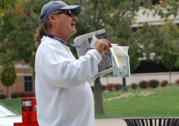Joseph Ramirez, Street Speech vendor, sells newspapers outside Starbucks on High Street on Sept. 23. Ramirez has been selling the paper since 2008, and typically makes his sales on OSU's campus. Credit: Haley Kim / Lantern photographer
