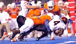 Courtesy of MCT San Diego State running back Adam Muema (4) is tackled after a run during a game against Boise State Nov. 3, 2012, at Bronco Stadium. SDSU won, 21-19.