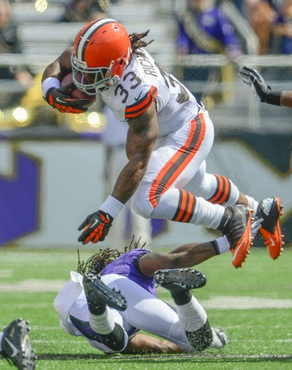 Cleveland Browns running back Trent Richardson hurdles Baltimore Ravens cornerback Lardarius Webb on a run from scrimmage during the first half of their game on Sunday, September 15, 2013, in Baltimore, Maryland. (Doug Kapustin/MCT). Credit: Courtesy of MCT