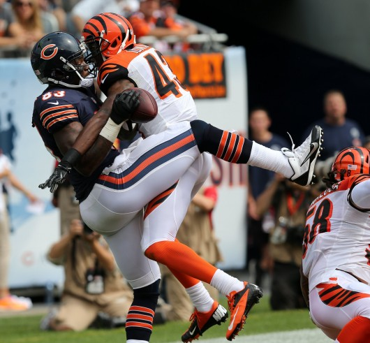 Chicago Bears tight end Martellus Bennett (83) makes a touchdown catch against Cincinnati Bengals free safety George Iloka (43) during the first quarter at Soldier Field in Chicago, Illinois, on Sunday, September 8, 2013. Credit: Courtesy of MCT