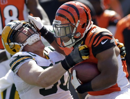 Green Bay Packers inside linebacker A.J. Hawk (50) is stiff-armed by Cincinnati Bengals running back Giovani Bernard (25) during the second quarter on Sunday, September 22, 2013, at Paul Brown Stadium in Cincinnati, Ohio. Credit: Courtesy of MCT