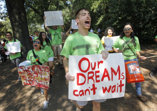 UNC-Chapel Hill students march outside Reynolds Coliseum at N.C. State with a coalition of student organizations voicing their support for the Dream Act and asking President Barack Obama to stop deportations, Sept. 14, 2011 in Raleigh, N.C.