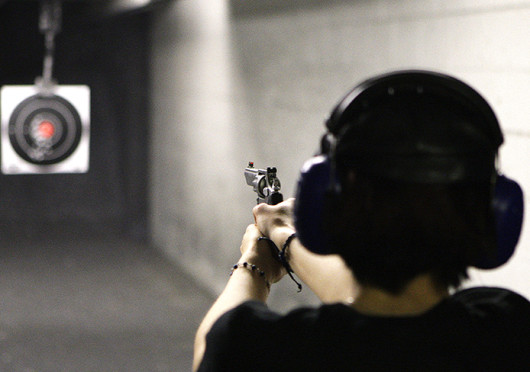A shooter practices her aim. Concealed carry is prohibited on OSU's campus, a policy some say leaves students more likely to be victimized by campus crime.