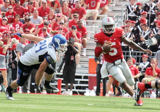 Then-junior quarterback Braxton Miller (5) runs down the field for extra yards in a game against Buffalo Aug. 31 at Ohio Stadium. OSU won, 40-20. Miller will move to a new position for the Buckeyes for the 2015 season. Credit: Lantern file photo