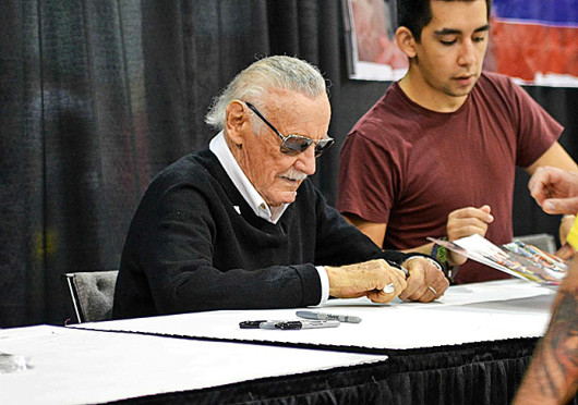 Stan Lee signs photos for fans at the Wizard World Ohio Comic Con on Sept. 21 at the Greater Columbus Convention Center. Credit: Judy Won / For The Lantern