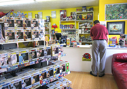 A customer shopping at Packrat Comics, located in Hilliard at 3872 Lattimer St. Packrat Comics is set to host a Comic Con kickoff party at noon on Sept. 20. Credit: Kim Dailey / Lantern reporter