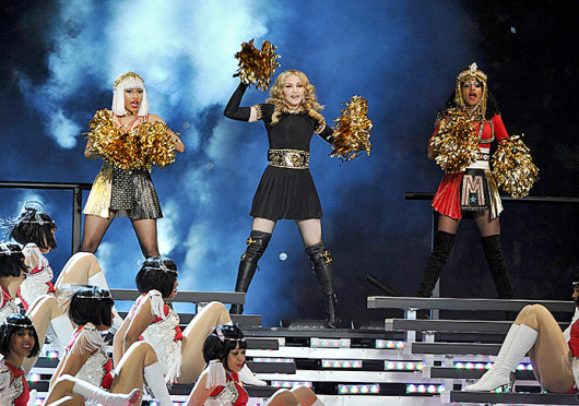 Nikki Minaj (from left), Madonna and MIA perform at the 2012 Super Bowl halftime show. MIA has been fined $1.5 million by the NFL for this performance, in which she flipped off the camera. Credit: Courtesy of MCT