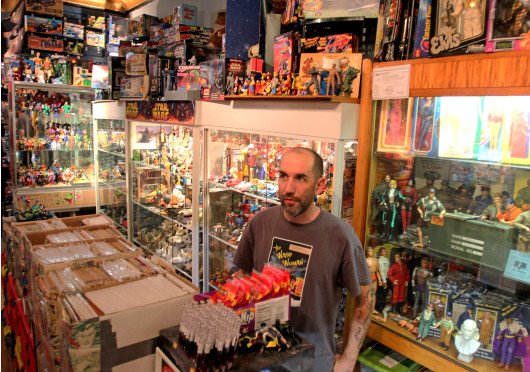 Jason Williams, co owner of Big Fun Toy Store, talks to customers. Big Fun is located at 672 N. High St. Credit: Shelby Lum / Photo editor