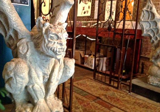 A gargoyle statue sits inside Vinyl Frontier, a record store which was located at 51 E. Gay St. before closing in July. Credit: Courtesy of Justin Crockett