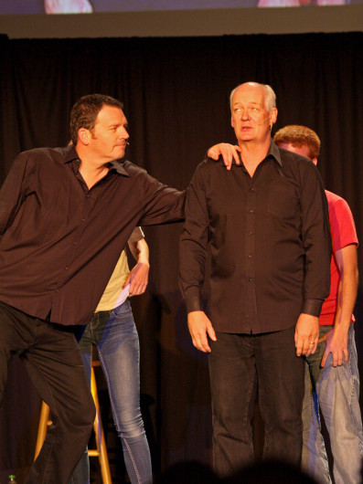 Comedians Brad Sherwood (left), and Colin Mochrie interact with audience members for a game during their show Sept. 16 in the Archie M. Griffin Grand Ballroom. Credit: Shelby Lum / Photo editor