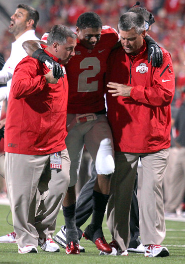 Senior safety Christian Bryant (2) is helped off the field after breaking his ankle during a game against Wisconsin Sept. 28 at Ohio Stadium. OSU won, 31-24. Credit: Shelby Lum / Photo editor