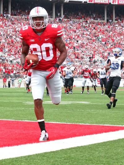 Kaily Cunningham / Multimedia editor Redshirt-senior Chris Fields catches a touchdown during a game against Buffalo Aug. 31, at Ohio Stadium. OSU won, 40-20.