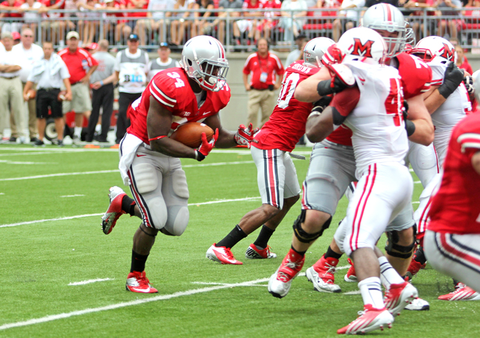 Then-junior running back Carlos Hyde breaks through the line during a game against Miami (Ohio) Sept. 1, 2012 at Ohio Stadium. OSU won, 56-10. Credit: Lantern file photo