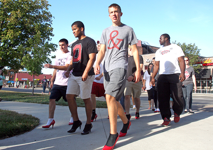 Male OSU students walk in high heels on OSU's campus Sept. 4 to raise awareness for domestic violence as part of Walk a Mile. Credit: Shelby Lum / Photo editor