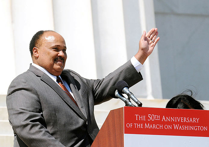 Martin Luther King III, the oldest son of Martin Luther King Jr., waves to the crowd from the steps of the Lincoln Memorial during a  celebration of the 50th anniversary of the March on Washington in Washington, D.C., Aug. 24. Credit: Courtesy of MCT