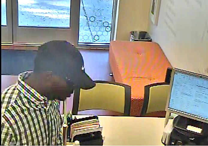A screenshot from security footage at Huntington National bank located at 235 W. 11th Ave. around 9:25 a.m. Sept. 14. Credit: Courtesy of University Police