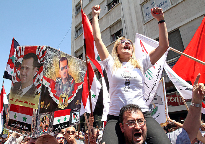 Syrians stage a sit-in at Youssef al-Azmeh Square in Damascus, Syria, Sept. 9 in a protest against US threats to launch a military strike against their country. Credit: Courtesy of MCT