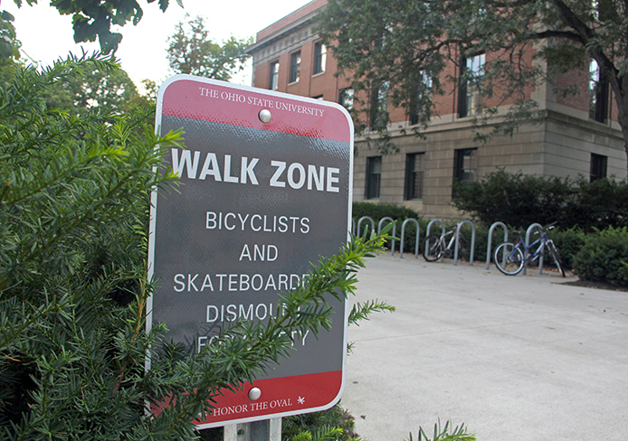 A safety sign outside Derby Hall noting the Walk Zone near the Oval. Credit: Ritika Shah / Asst. photo editor