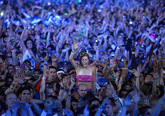 Ravers dance during a set by DJ Porter Robinson during the 2nd day of the Electric Daisy Carnival at the Las Vegas Motor Speedway in Las Vegas June 25, 2011.
