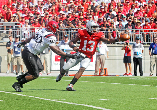 Redshirt-senior quarterback Kenny Guiton pitches the ball during a game against San Diego State Sept. 7, at Ohio Stadium. OSU won, 42-7. Credit: Ritika Shah / Assistant photo editor