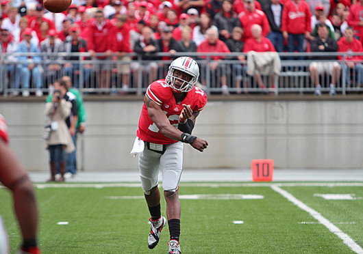 Redshirt-senior quarterback Kenny Guiton throws a pass during a game against Florida A&M Sept. 21 at Ohio Stadium. OSU won, 76-0.