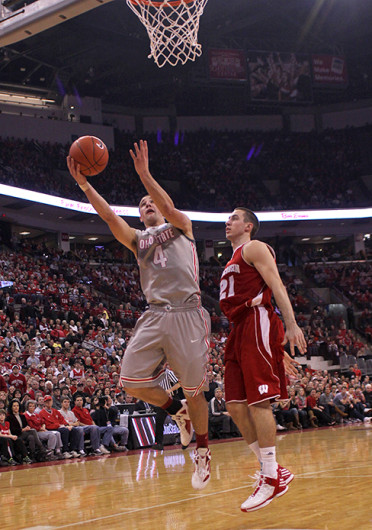 Then-sophomore point guard Aaron Craft (4) tries to score during a game against Wisconsin Feb. 26, 2012, at Value City Arena. OSU lost, 63-60. Credit: For The Lantern