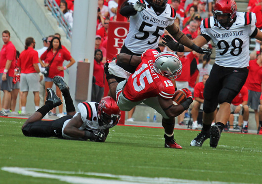 Freshman running back Ezekiel Elliott gets tripped up during a game against San Diego State Sept. 7, at Ohio Stadium. OSU won, 42-7.