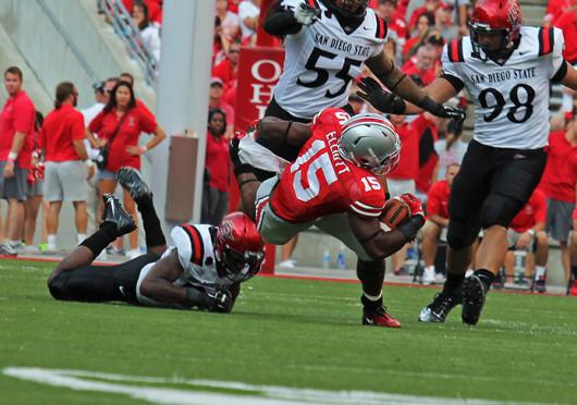 Freshman running back Ezekiel Elliott gets tripped up during a game against San Diego State Sept. 7, at Ohio Stadium. OSU won, 42-7.