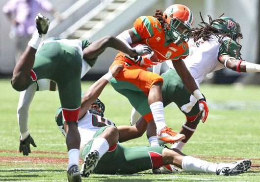 Florida A&M receiver Lenworth Lennon tries to break away from defenders during the MEAC/SWAC Challenge presented by Disney at the Citrus Bowl in Orlando, Florida, Sunday, September 1, 2013. Florida A&M defeated Mississippi Valley State, 27-10.  Credit: Courtesy of MCT