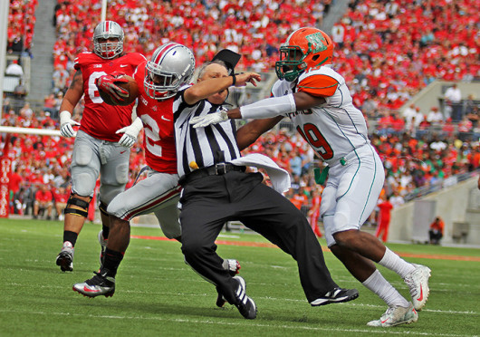 Redshirt-senior running back Jordan Hall (2) uses the referee as a blocker during a game against Florida A&M Sept. 21 at Ohio Stadium. OSU won, 76-0. Credit: Shelby Lum / Photo editor