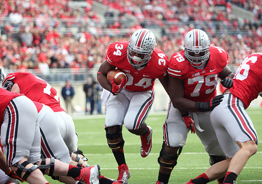 Then-junior running back Carlos Hyde (34) breaks through the line during a game against Illinois Nov. 3, 2012, at Ohio Stadium. OSU won, 52-22. Credit: Lantern file photo