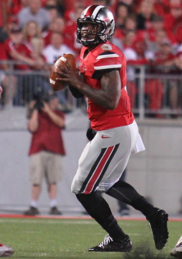 Junior quarterback Braxton Miller (5) drops back in the pocket during a game against Wisconsin Sept. 28 at Ohio Stadium. OSU won, 31-24. Credit: Shelby Lum / Photo editor