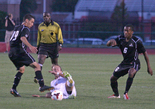 Sophomore midfielder Zach Mason (7) slides for the ball during a match against Wright State Sept. 17 at Jesse Owens Memorial Stadium. The teams tied, 0-0. Credit: Shelby Lum / Photo editor