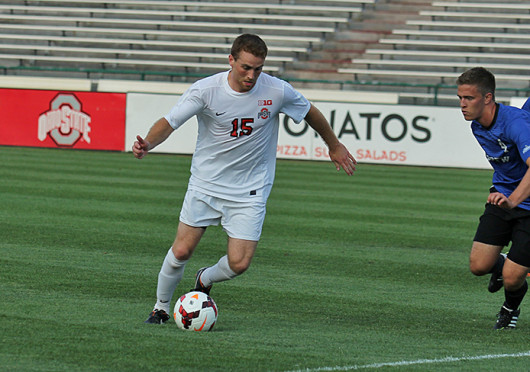 Senior forward Denio Leone (15) works around defenders during a match against IPFW Aug. 20 at Ohio Stadium. OSU won, 2-0. Credit: Shelby Lum / Photo editor