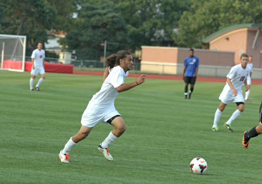 Shelby Lum / Photo editor Junior midfielder Yianni Sarris advances the ball during a game against IPFW Aug. 20, at Jesse Owens Memorial Stadium. OSU won, 2-0.