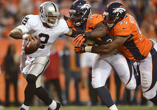 Oakland Raiders quarterback Terrelle Pryor (2) avoids the sack during a game against the Denver Broncos Sept. 23 at Sports Authority Field. Denver won, 37-21. Credit: Courtesy of MCT