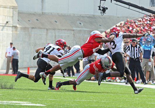 Junior linebacker Ryan Shazier (10) and redshirt-junior cornerback Bradley Roby (1) make a tackle during a game against San Diego State Sept. 7, at Ohio Stadium. OSU won, 42-7.